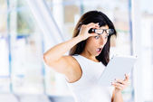 Surprised modern businesswoman with tablet — Stock Photo
