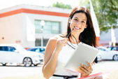 Car sales woman with tablet in trade show — Stock Photo