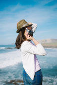 Funky woman taking photo on travel — Stock Photo