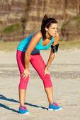 Female runner fatigue on training — Stock Photo