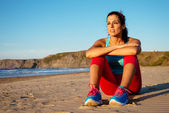 Relaxed fitness woman resting at beach — Stock Photo