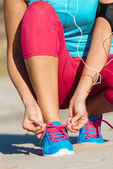 Runner lacing sport footwear  — Stock Photo
