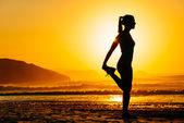 Woman exercising on beautiful morning — Stock Photo