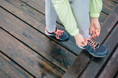 Woman lacing running sport shoes — Stock Photo