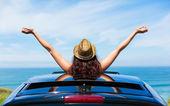 Woman on car travel freedom enjoying freedom — Stock Photo