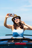 Woman taking selfie photo on car summer vacation — Stock Photo