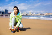 Fitness female runner at city beach — Stock Photo