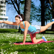 Fitness woman on stretching workout in park — Stock Photo #51016963