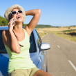 Woman talking on cellphone during summer car travel — Stock Photo #51018363