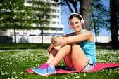 Relaxed happy fitness woman resting — Stock Photo
