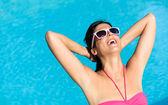 Joyful woman on summer leisure at swimming pool — Stock Photo