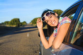 Happy woman on summer car travel — Stock Photo