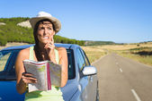 Lost woman on car roadtrip travel problem — Stock fotografie