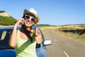 Woman calling on cellphone during summer car travel — Stock Photo