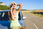 Woman talking on  cellphone during summer car travel  — Stock Photo