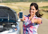 Successful call to car service on roadtrip — Stock Photo