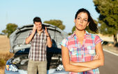 Couple waiting for car service after breakdown — Stock Photo