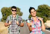 Couple in road hiking summer travel vacation — Stock Photo