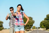 Happy couple in road hiking summer vacation — Stock Photo