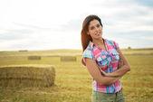 Female farmer in country field — Stock Photo