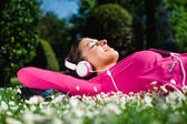 Relaxed female athlete resting and day dreaming — Stock Photo