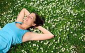 Female athlete resting and relaxing on spring — Stock Photo