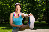 Woman stretching leg outdoor — Stock Photo