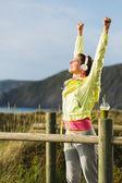 Fitness woman celebrating workout success — Stock Photo