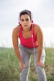 Tired female athlete taking an exercising break — Stock Photo