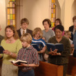 Singing Hymns in Church - Stock Photo
