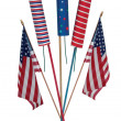 Fourth of July skyrockets and US flags - Stock Photo