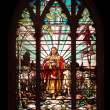 Stained glass window with Jesus - Stock Photo