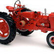 Red tractor on white - 图库照片