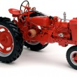 Red tractor on white - Foto Stock