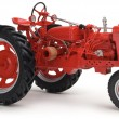 Red tractor on white background — Stock Photo #13455463