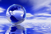 A high quality Glass 3d earth over a clean ocean reflecting the deep blue skyscape. — Stock Photo
