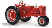 Red tractor on white background — Stock Photo