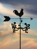 Weathervane against cloudscape — Stock Photo