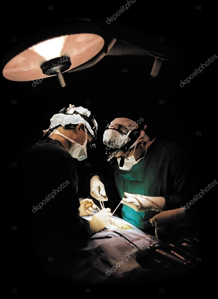 A photo of two surgeons operating — Stock Photo #13454220