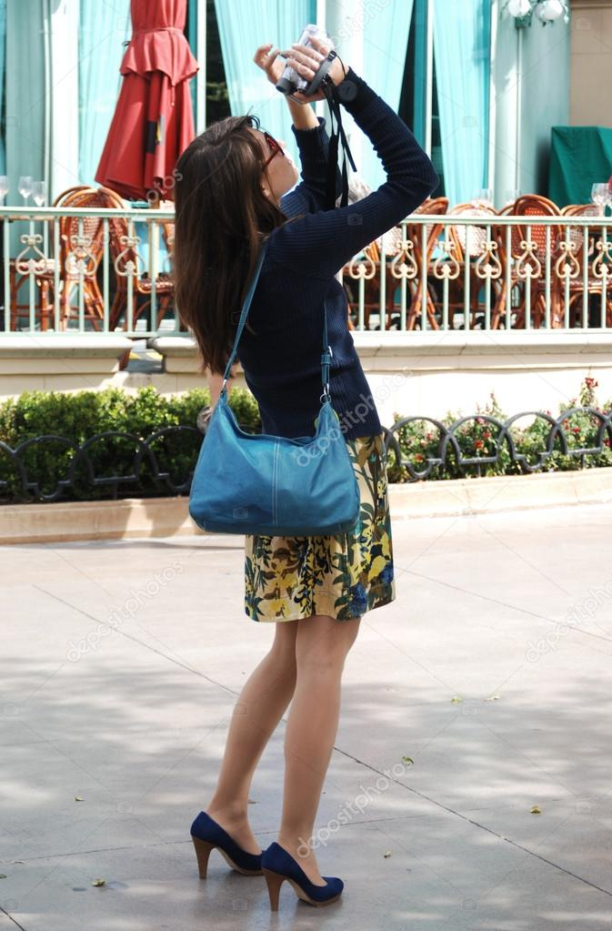 Young woman tourist taking pictures — Stock Photo #13455425