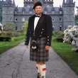 Scottish Man in front of Inverary Castle - Stock Photo