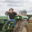 Farmer on Tractor — Stock Photo #13471193