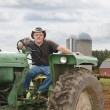 Farmer on Tractor - Stock Photo