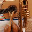 Accoustic guitar, maracas and trumpet on mexican fabric — Stock Photo #13471197