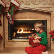 Boy with a Christmas Gift - Foto Stock