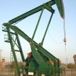 Oil pump rig in daylight — Stok fotoğraf