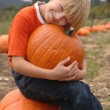 Stock Photo: Pumpkin Patch Boy
