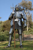 Knight standing with battle axe — Stock Photo