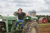 Farmer on Tractor — Stock Photo