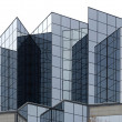 Angular glass office building exterior - Foto Stock